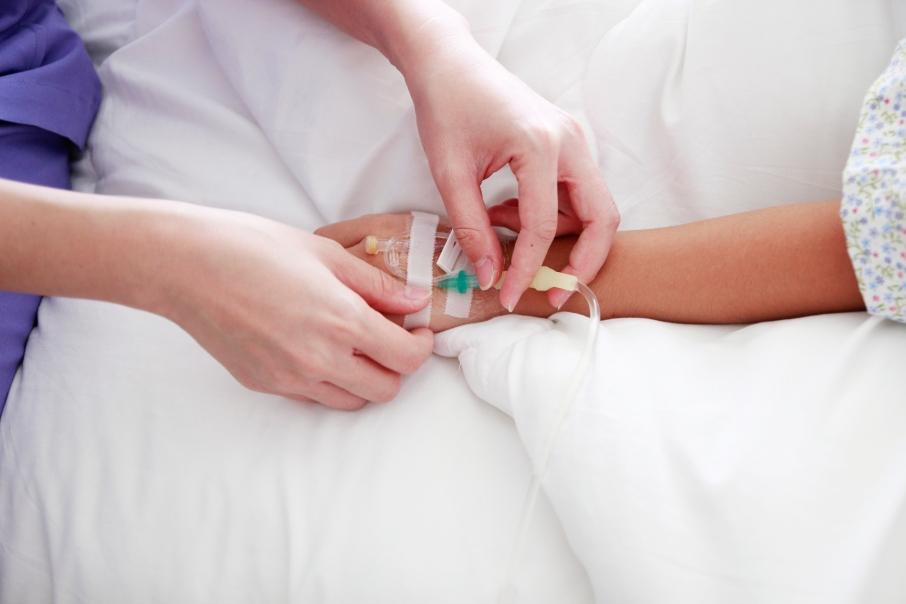 hand of nurse put intravenous(IV) injectionpatient on patient h